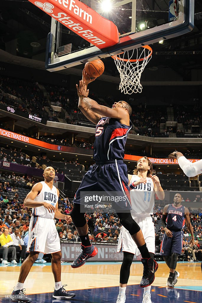 <a gi-track='captionPersonalityLinkClicked' href=/galleries/search?phrase=Al+Horford&family=editorial&specificpeople=699030 ng-click='$event.stopPropagation()'>Al Horford</a> #15 of the Atlanta Hawks shoots against the Charlotte Bobcats during the game at the Time Warner Cable Arena on November 11, 2013 in Charlotte, North Carolina.