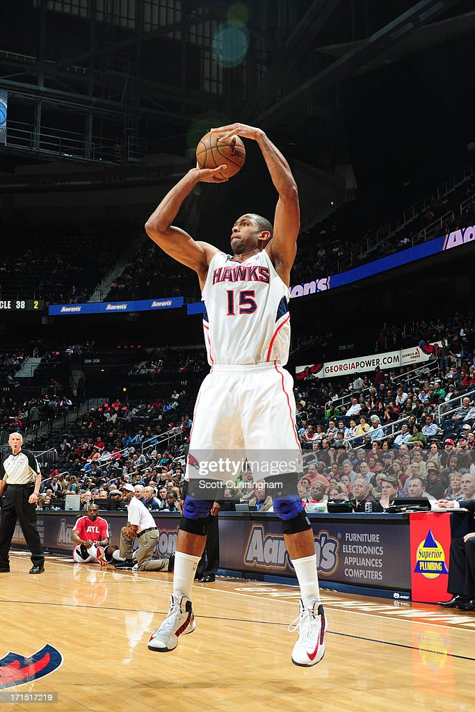 <a gi-track='captionPersonalityLinkClicked' href=/galleries/search?phrase=Al+Horford&family=editorial&specificpeople=699030 ng-click='$event.stopPropagation()'>Al Horford</a> #15 of the Atlanta Hawks shoots against the Dallas Mavericks on March 18, 2013 at Philips Arena in Atlanta, Georgia.