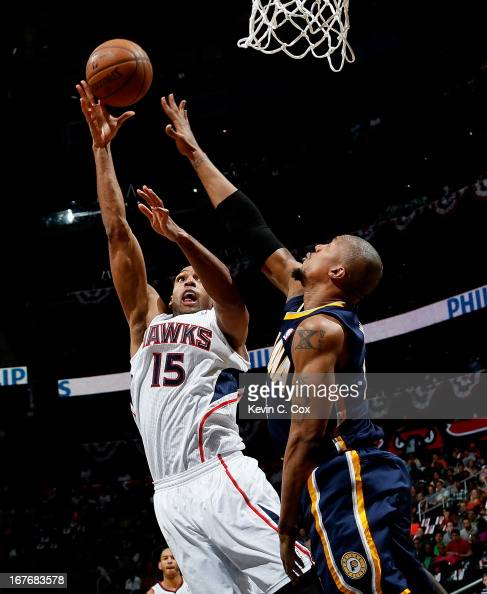 Al Horford of the Atlanta Hawks shoots over David West of the Indiana Pacers during Game Three of the Eastern Conference Quarterfinals of the 2013...