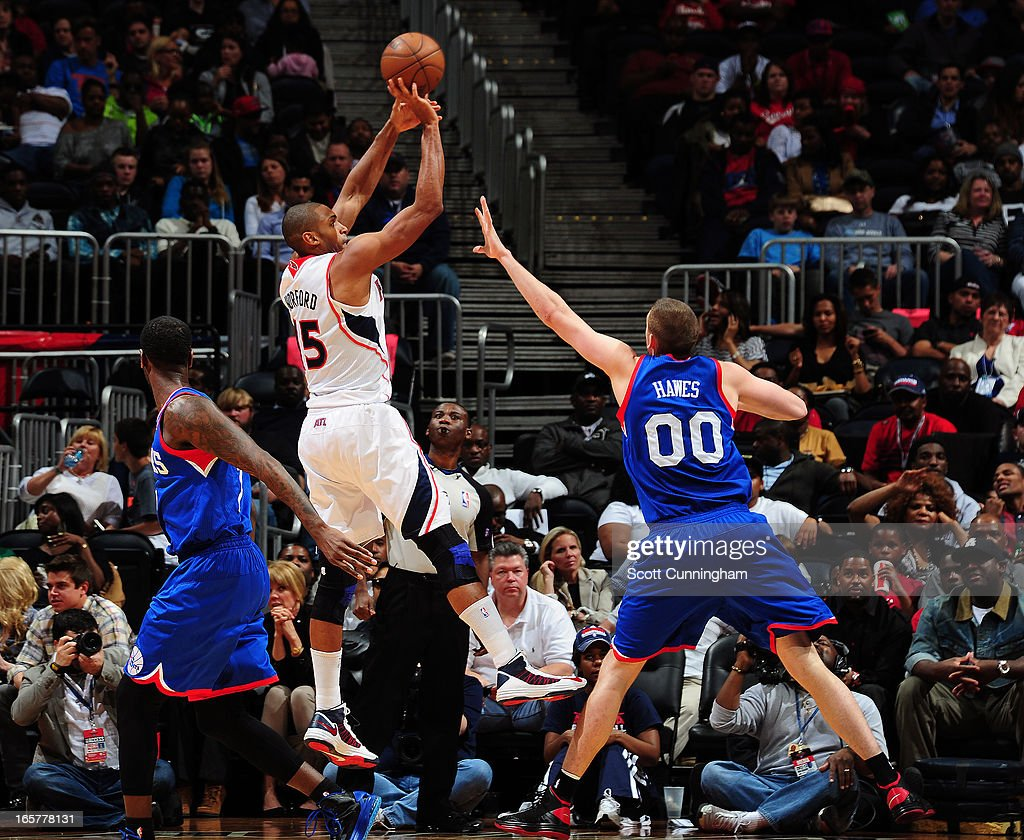 <a gi-track='captionPersonalityLinkClicked' href=/galleries/search?phrase=Al+Horford&family=editorial&specificpeople=699030 ng-click='$event.stopPropagation()'>Al Horford</a> #15 of the Atlanta Hawks shoots the ball against <a gi-track='captionPersonalityLinkClicked' href=/galleries/search?phrase=Spencer+Hawes&family=editorial&specificpeople=3848319 ng-click='$event.stopPropagation()'>Spencer Hawes</a> #00 of the Philadelphia 76ers on April 5, 2013 at Philips Arena in Atlanta, Georgia.
