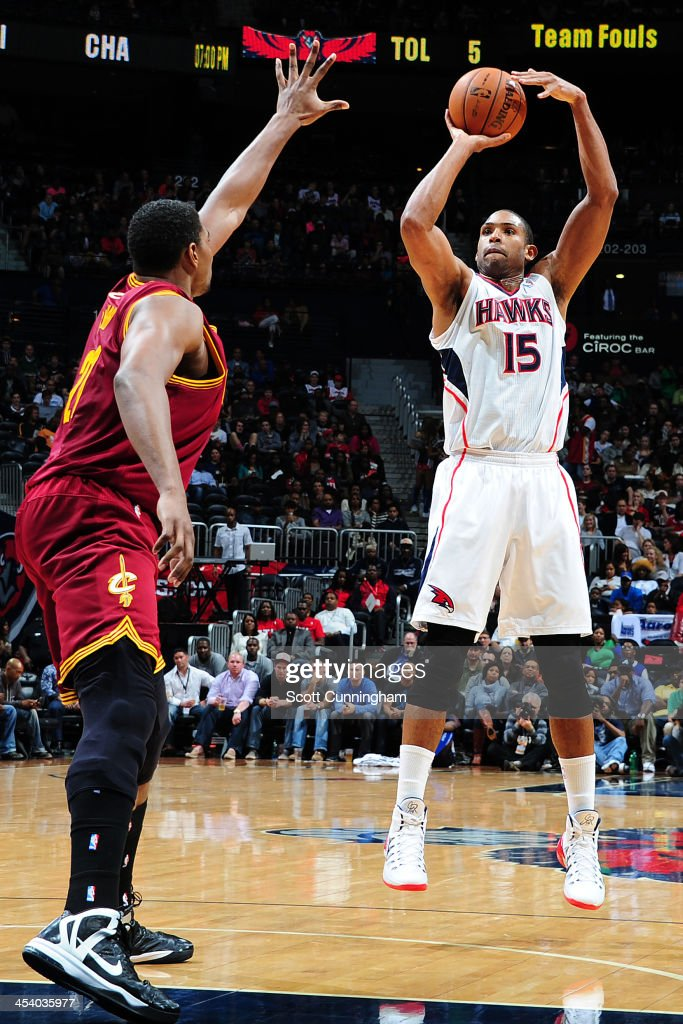 <a gi-track='captionPersonalityLinkClicked' href=/galleries/search?phrase=Al+Horford&family=editorial&specificpeople=699030 ng-click='$event.stopPropagation()'>Al Horford</a> #15 of the Atlanta Hawks shoots the ball against the Cleveland Cavaliers on December 6, 2013 at Philips Arena in Atlanta, Georgia.
