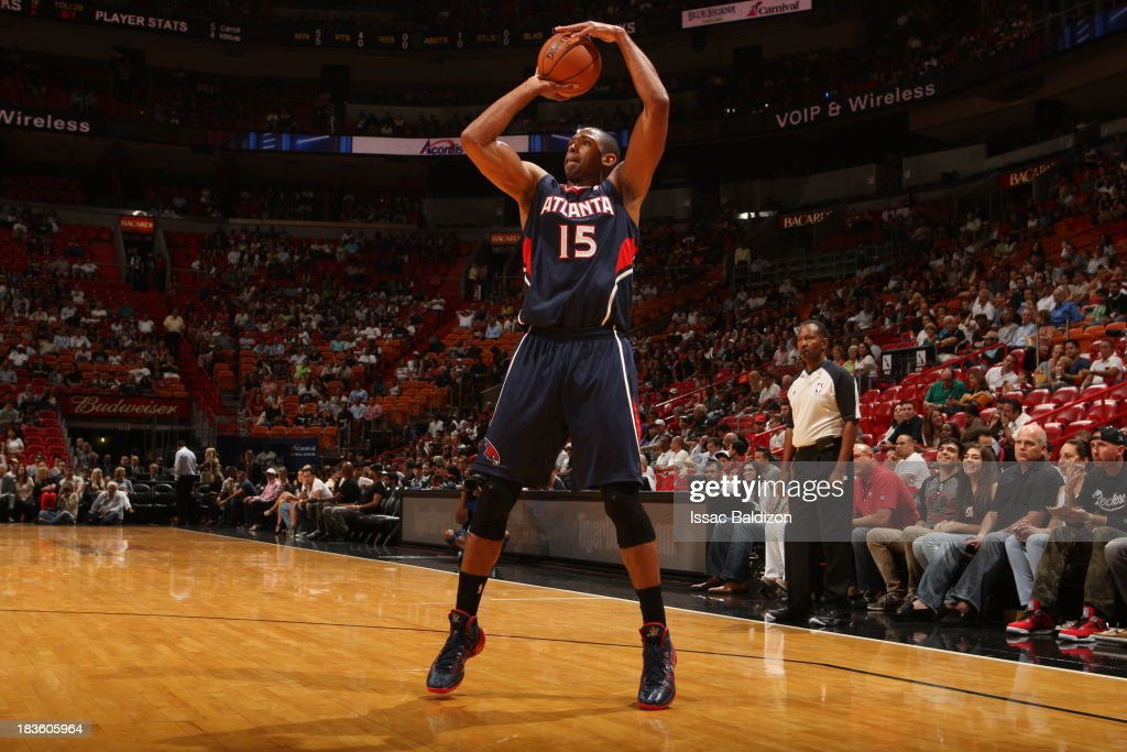 <a gi-track='captionPersonalityLinkClicked' href=/galleries/search?phrase=Al+Horford&family=editorial&specificpeople=699030 ng-click='$event.stopPropagation()'>Al Horford</a> #15 of the Atlanta Hawks shoots the ball against the Miami Heat during a game on October 7, 2013 at American Airlines Arena in Miami, Florida.