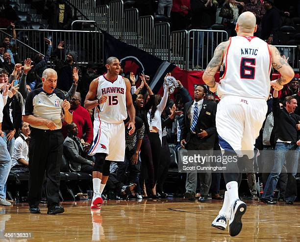 Al Horford of the Atlanta Hawks smiles after hitting the game winning shot against the Washington Wizards on December 13 2013 at Philips Arena in...