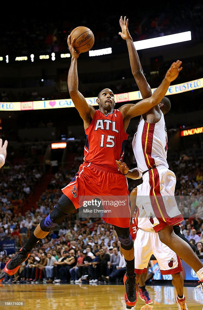 Al Horford #15 of the Atlanta Hawks takes a shot during a game against the Miami Heat at American Airlines Arena on December 10, 2012 in Miami, Florida.