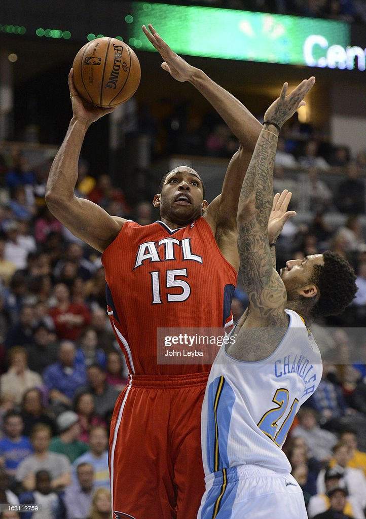 Al Horford (15) of the Atlanta Hawks takes a shot over Wilson Chandler (21) of the Denver Nuggets during the fourth quarter March 4, 2013 at Pepsi Center. The Denver Nuggets defeated the Atlanta Hawks 104-88.