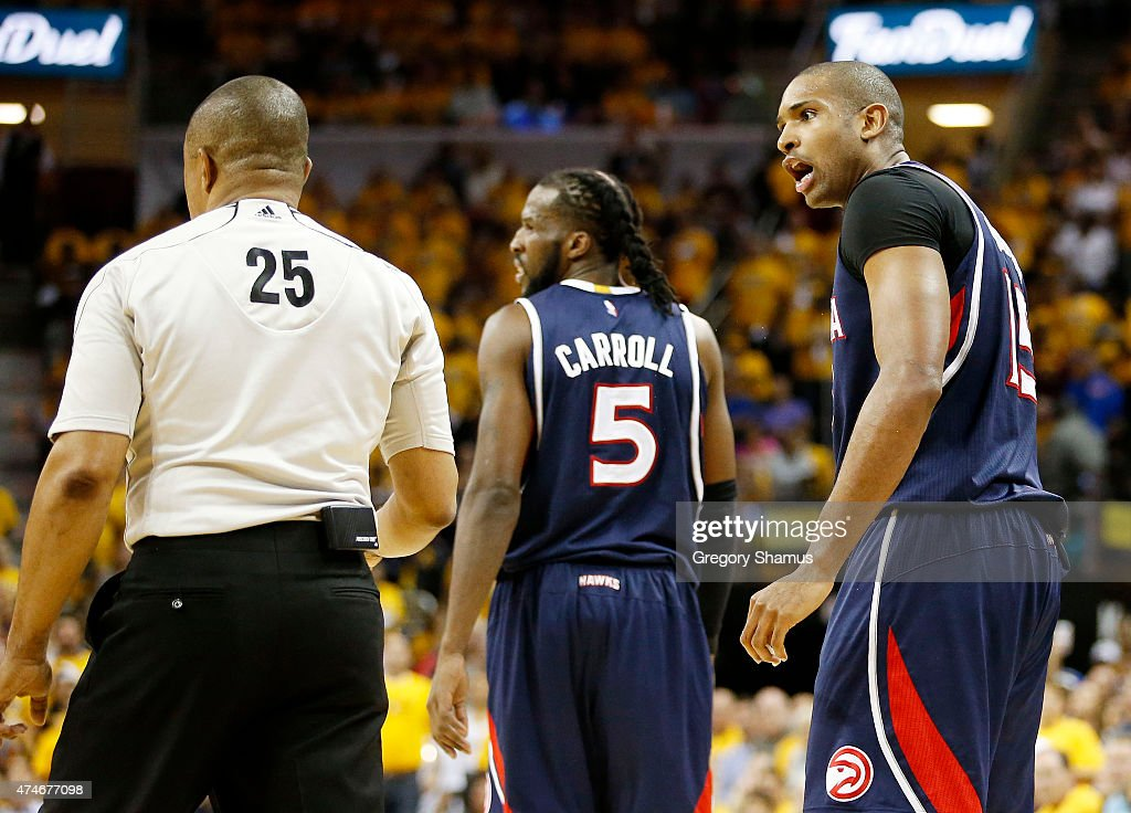 Al Horford of the Atlanta Hawks talks to referee Tony Brothers before being ejected from the game in the second quarter against the Cleveland...