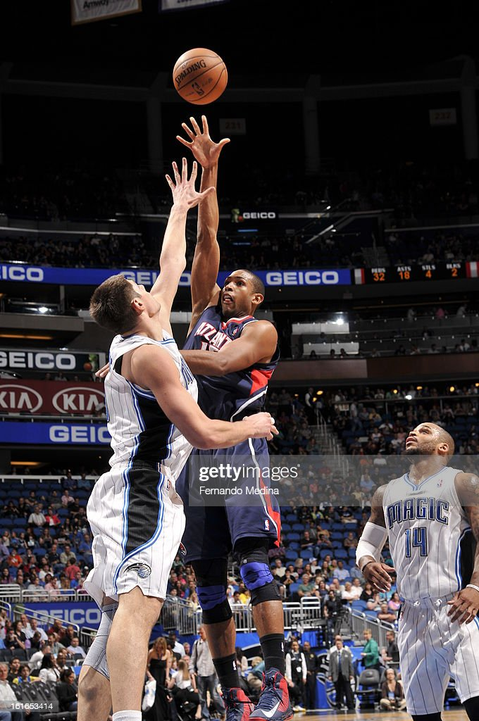 Al Horford #15 of the Atlanta Hawks throws up a shot against the Orlando Magic during the game on February 13, 2013 at Amway Center in Orlando, Florida.