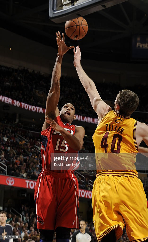 Al Horford #15 of the Atlanta Hawks tosses up the shot against Tyler Zeller #40 of the Cleveland Cavaliers at The Quicken Loans Arena on December 28, 2012 in Cleveland, Ohio.