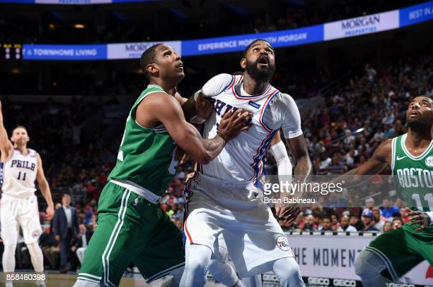 Al Horford of the Boston Celtics and Amir Johnson of the Philadelphia 76ers box each other out on October 6 2017 in Philadelphia Pennsylvania at the...