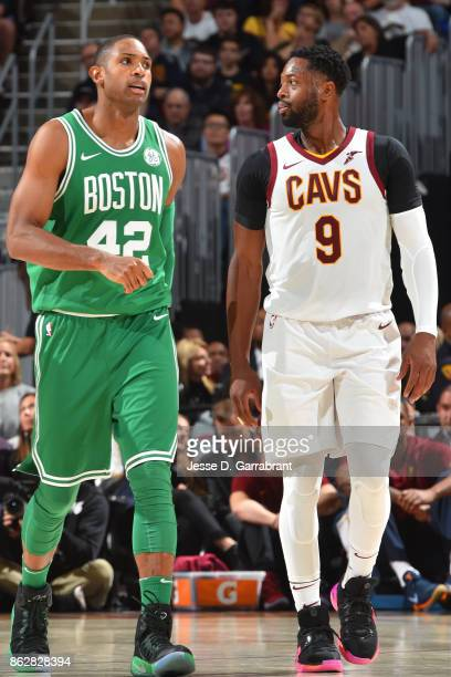 Al Horford of the Boston Celtics and Dwyane Wade of the Cleveland Cavaliers walk up court on October 17 2017 at Quicken Loans Arena in Cleveland Ohio...