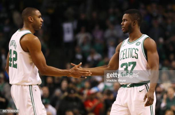 Al Horford of the Boston Celtics and Semi Ojeleye celebrate during the second half against the Dallas Mavericks at TD Garden on December 6 2017 in...