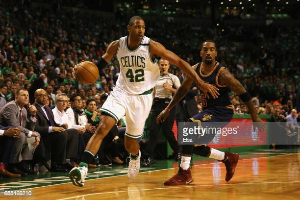 Al Horford of the Boston Celtics dribbles against JR Smith of the Cleveland Cavaliers in the first half during Game Five of the 2017 NBA Eastern...