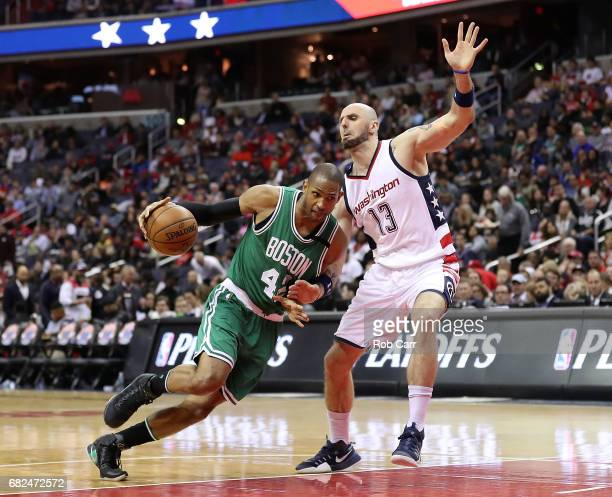 Al Horford of the Boston Celtics drives against Marcin Gortat of the Washington Wizards during Game Six of the NBA Eastern Conference SemiFinals at...