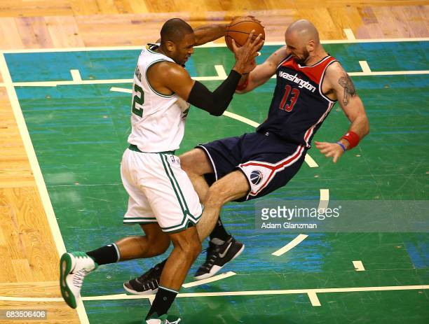 Al Horford of the Boston Celtics drives against Marcin Gortat of the Washington Wizards during Game Seven of the NBA Eastern Conference SemiFinals at...