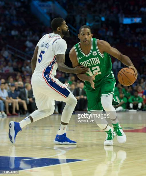 Al Horford of the Boston Celtics drives to the basket against Amir Johnson of the Philadelphia 76ers at the Wells Fargo Center on October 6 2017 in...