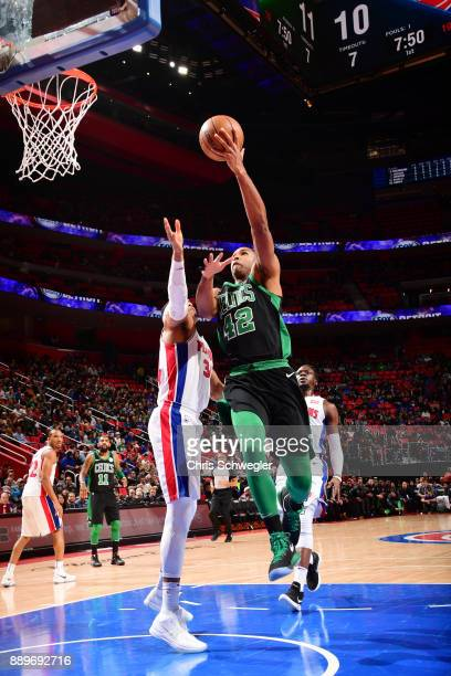Al Horford of the Boston Celtics drives to the basket against the Detroit Pistons on December 10 2017 at Little Caesars Arena in Detroit Michigan...