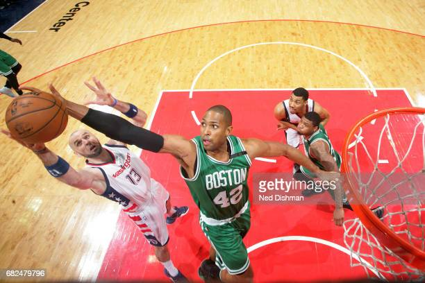 Al Horford of the Boston Celtics goes for the rebound against Marcin Gortat of the Washington Wizards during Game Six of the Eastern Conference...