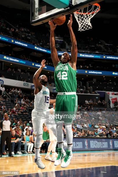 Al Horford of the Boston Celtics goes to the basket against the Charlotte Hornets on October 11 2017 at Spectrum Center in Charlotte North Carolina...