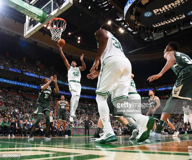 Al Horford of the Boston Celtics goes to the basket against the Milwaukee Bucks on October 18 2017 at the TD Garden in Boston Massachusetts NOTE TO...