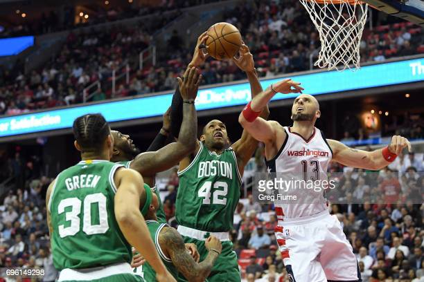 Al Horford of the Boston Celtics grabs a rebound against the Washington Wizards in Game Three of the Eastern Conference Semifinals at Verizon Center...