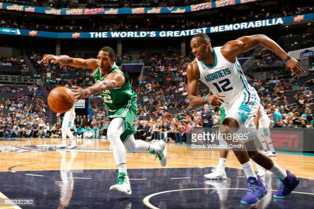 Al Horford of the Boston Celtics grabs possession of the ball against the Charlotte Hornets on October 11 2017 at Spectrum Center in Charlotte North...