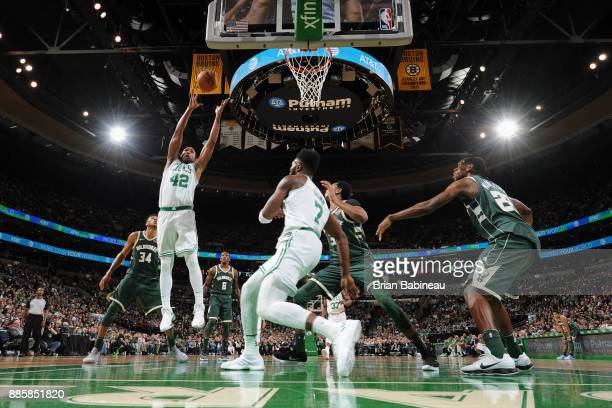 Al Horford of the Boston Celtics grabs the rebound against the Milwaukee Bucks on December 4 2017 at the TD Garden in Boston Massachusetts NOTE TO...