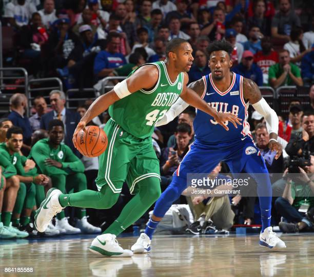 Al Horford of the Boston Celtics handles the ball against Robert Covington of the Philadelphia 76ers during the game on October 20 2017 at Wells...