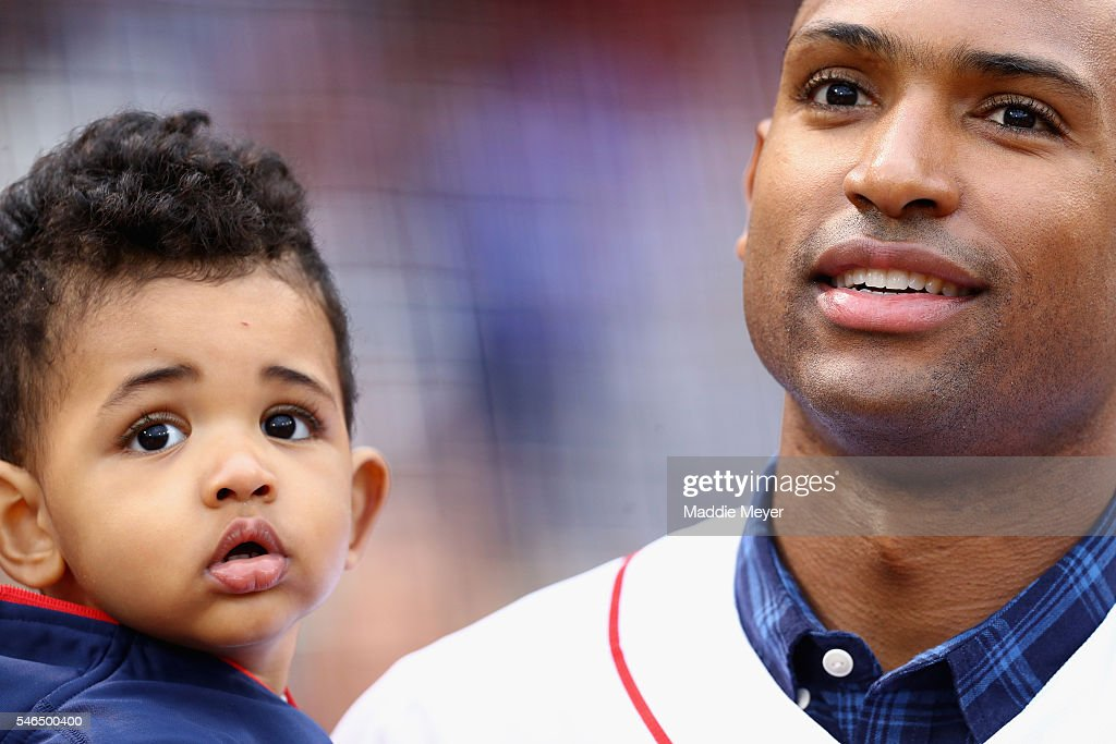 Al Horford of the Boston Celtics holds his son Ean before the game between the Boston Red Sox and the Tampa Bay Rays at Fenway Park on July 8 2016 in...