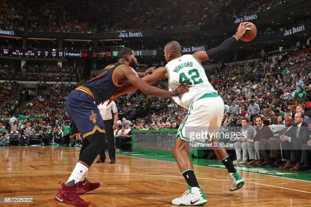 Al Horford of the Boston Celtics holds the ball away from Tristan Thompson of the Cleveland Cavaliers in Game Two of the Eastern Conference Finals...