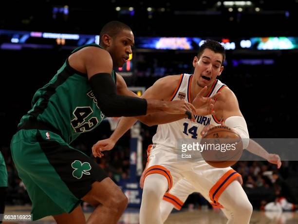 Al Horford of the Boston Celtics loses the ball as Willy Hernangomez of the New York Knicks defends at Madison Square Garden on April 2 2017 in New...