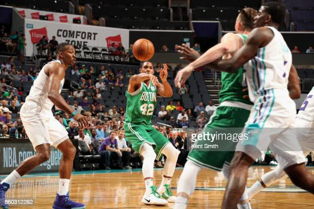 Al Horford of the Boston Celtics passes the ball against the Charlotte Hornets on October 11 2017 at Spectrum Center in Charlotte North Carolina NOTE...