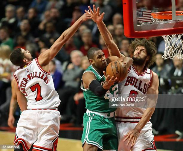 Al Horford of the Boston Celtics puts up a shot between Michael CarterWilliams and Robin Lopez of the Chicago Bulls during Game Three of the Eastern...