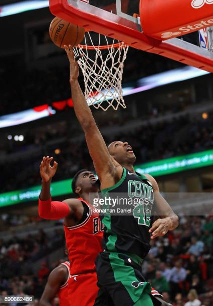 Al Horford of the Boston Celtics Puts up a shot past Bobby Portis of the Chicago Bulls at the United Center on December 11 2017 in Chicago Illinois...