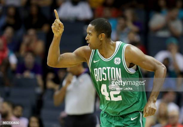 Al Horford of the Boston Celtics reacts after a play against the Charlotte Hornets during their game at Spectrum Center on October 11 2017 in...