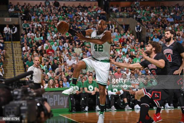 Al Horford of the Boston Celtics saves a ball from going out of bounds during the Eastern Conference Quarterfinals game against the Chicago Bulls...