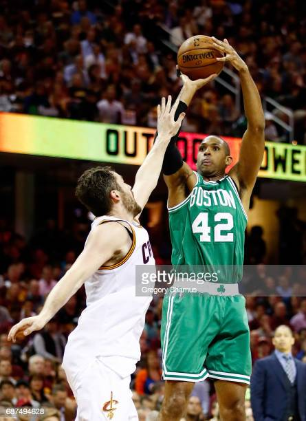 Al Horford of the Boston Celtics shoots against Kevin Love of the Cleveland Cavaliers in the first half during Game Four of the 2017 NBA Eastern...