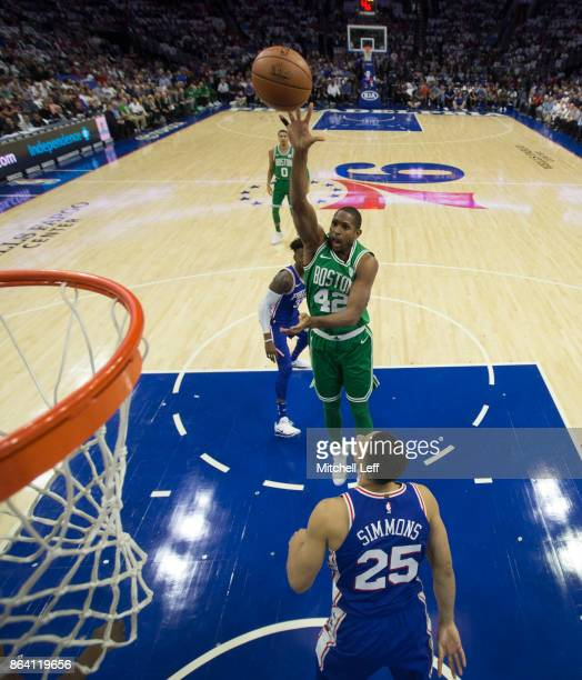 Al Horford of the Boston Celtics shoots the ball against Ben Simmons of the Philadelphia 76ers in the first quarter at the Wells Fargo Center on...