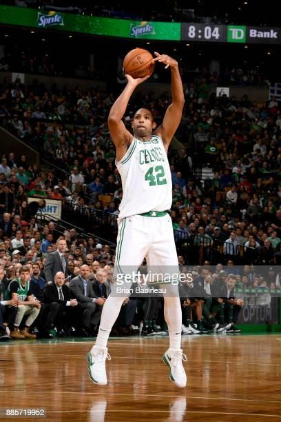 Al Horford of the Boston Celtics shoots the ball against the Milwaukee Bucks on December 4 2017 at the TD Garden in Boston Massachusetts NOTE TO USER...