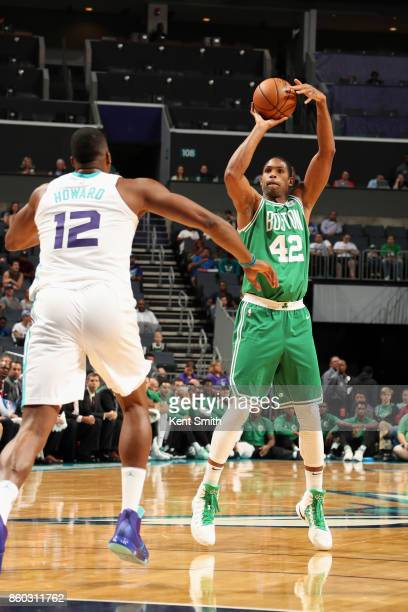 Al Horford of the Boston Celtics shoots the ball against the Charlotte Hornets on October 11 2017 at Spectrum Center in Charlotte North Carolina NOTE...