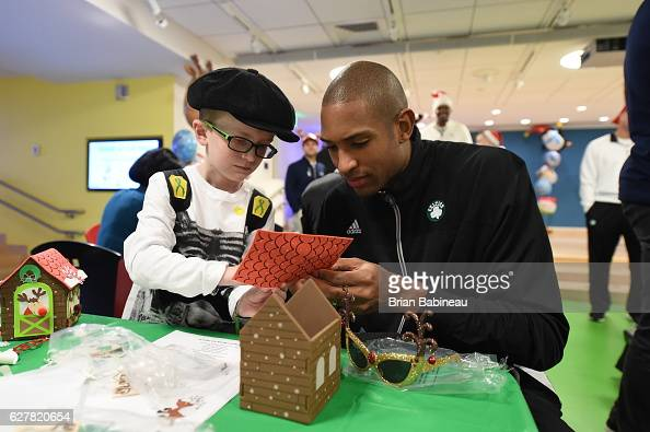 Al Horford of the Boston Celtics spreads holiday cheer duing a children's hospital visit on December 1 2016 at Boston Children's Hospital in Boston...