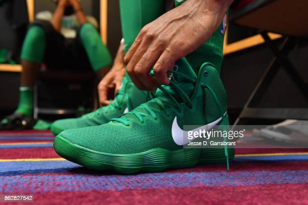 Al Horford of the Boston Celtics ties his sneakers before the game against the Cleveland Cavaliers on October 17 2017 at Quicken Loans Arena in...