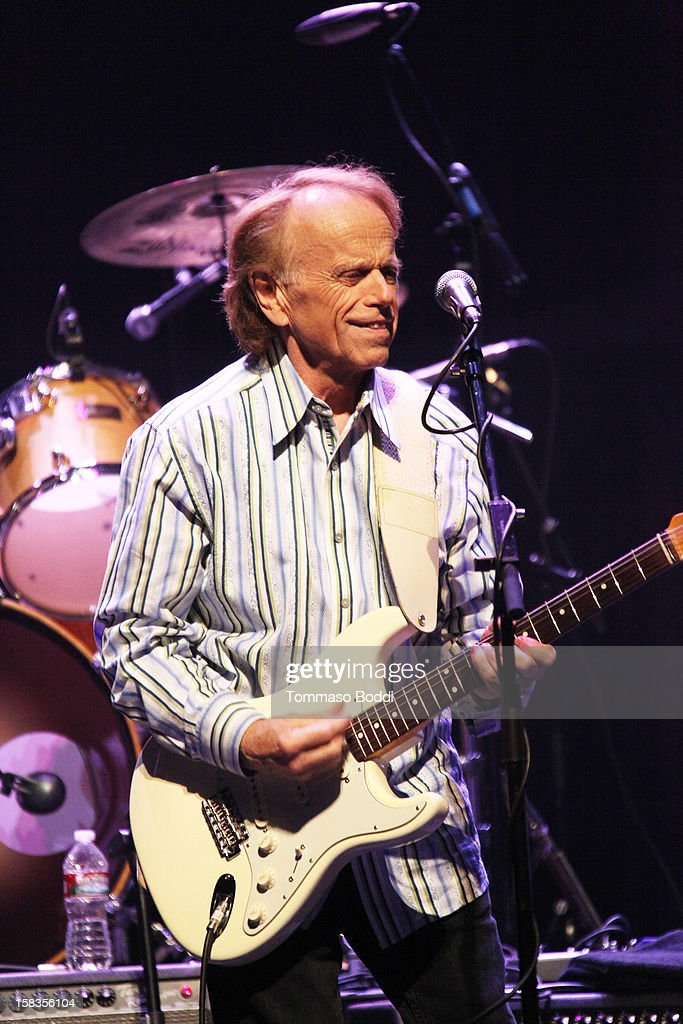 <a gi-track='captionPersonalityLinkClicked' href=/galleries/search?phrase=Al+Jardine&family=editorial&specificpeople=224030 ng-click='$event.stopPropagation()'>Al Jardine</a> of The Beach Boys performs with the KLOS All Star Band at the 95.5 KLOS Christmas Show held at Nokia Theatre L.A. Live on December 13, 2012 in Los Angeles, California.