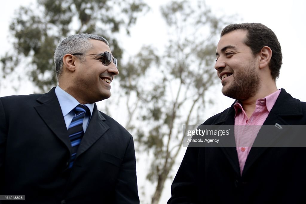 Al Jazeera journalists Baher Mohamed (R) and Mohamed Fahmy (L) are seen following a trial in Cairo, Egypt, on February 23, 2015. An Egyptian court on Monday adjourned to March 8 the trial of two journalists accused of 'inciting violence' a judicial source has said. According to the source, the court adjourned trial proceedings to March 8 in order to hear from prosecution witnesses and review 'evidence' introduced against the defendants. Earlier this month, Al Jazeera journalists Mohamed Fahmy and Baher Mohamed were both released from prison after an Egyptian court ordered their release pending trial.