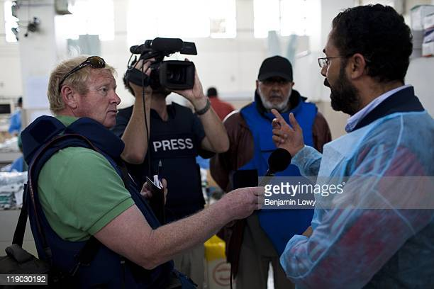 Al Jazeera reporter Tony Birtley and cameraman Benjamin Foley interview a Libyan doctor concerning civilian casualties at a hospital on March 19 2011...