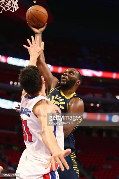 Al Jefferson Indiana Pacers shoots a first half shot over Boban Marjanovic of the Detroit Pistons during a pre season game at Little Caesars Arena on...
