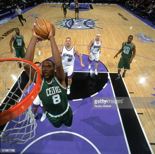 Al Jefferson of the Boston Celtics goes for a dunk during the game against the Sacramento Kings at Arco Arena on December 5 2004 in Sacramento...