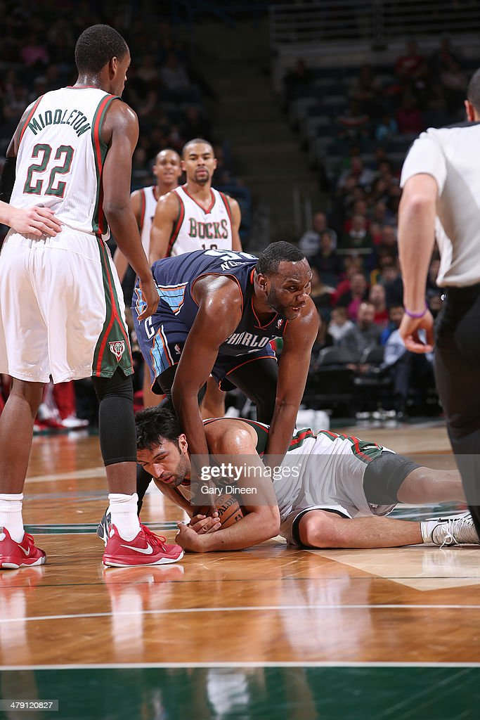 Al Jefferson #25 of the Charlotte Bobcats and Zaza Pachulia #27 of the Milwaukee Bucks battle for a loose ball on March 16, 2014 at the BMO Harris Bradley Center in Milwaukee, Wisconsin.