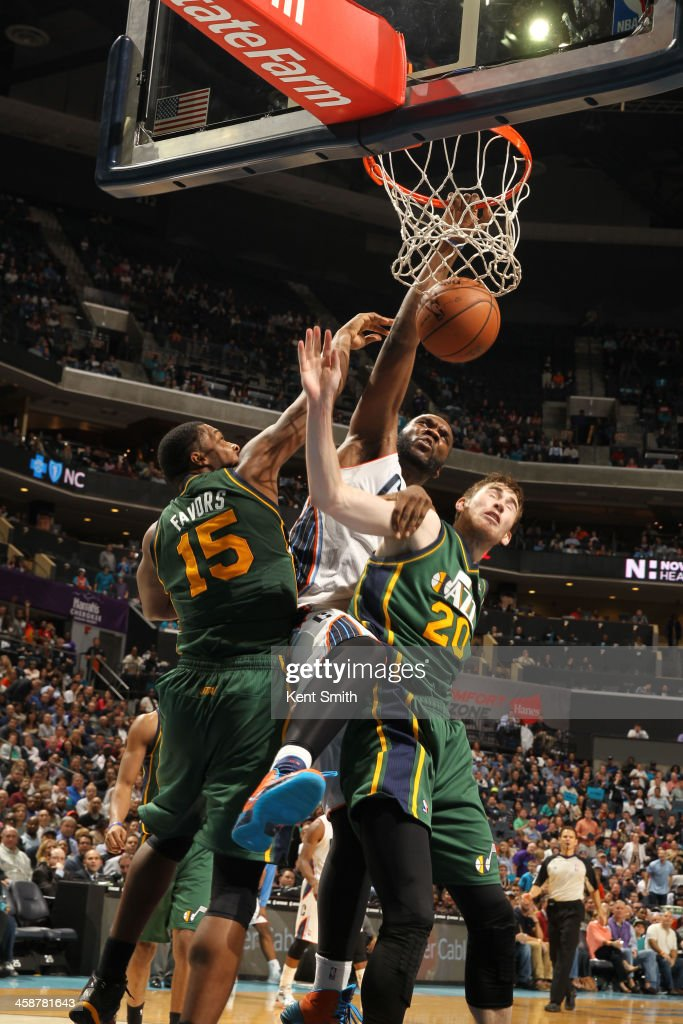 <a gi-track='captionPersonalityLinkClicked' href=/galleries/search?phrase=Al+Jefferson&family=editorial&specificpeople=201604 ng-click='$event.stopPropagation()'>Al Jefferson</a> #25 of the Charlotte Bobcats dunks against the Utah Jazz during the game at the Time Warner Cable Arena on December 21, 2013 in Charlotte, North Carolina.