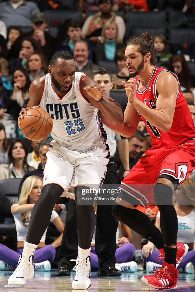 <a gi-track='captionPersonalityLinkClicked' href=/galleries/search?phrase=Al+Jefferson&family=editorial&specificpeople=201604 ng-click='$event.stopPropagation()'>Al Jefferson</a> #25 of the Charlotte Bobcats handles the ball against <a gi-track='captionPersonalityLinkClicked' href=/galleries/search?phrase=Joakim+Noah&family=editorial&specificpeople=699038 ng-click='$event.stopPropagation()'>Joakim Noah</a> #13 of the Chicago Bulls at the Time Warner Cable Arena on January 25, 2014 in Charlotte, North Carolina.