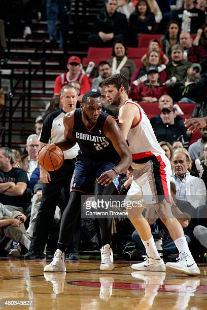 Al Jefferson of the Charlotte Bobcats handles the ball against Joel Freeland of the Portland Trail Blazers on January 2 2014 at the Moda Center Arena...